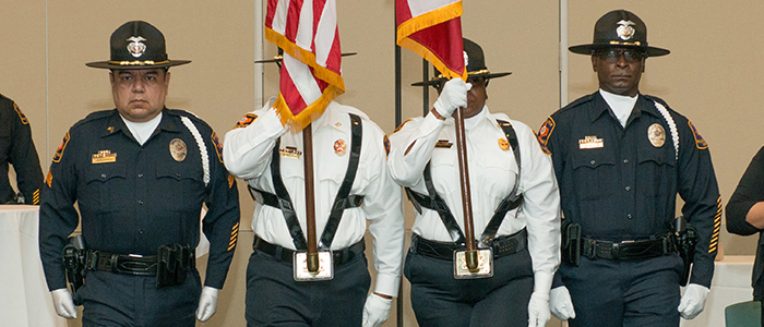 The UT Police Honor Guard presents the colors at a ceremony.